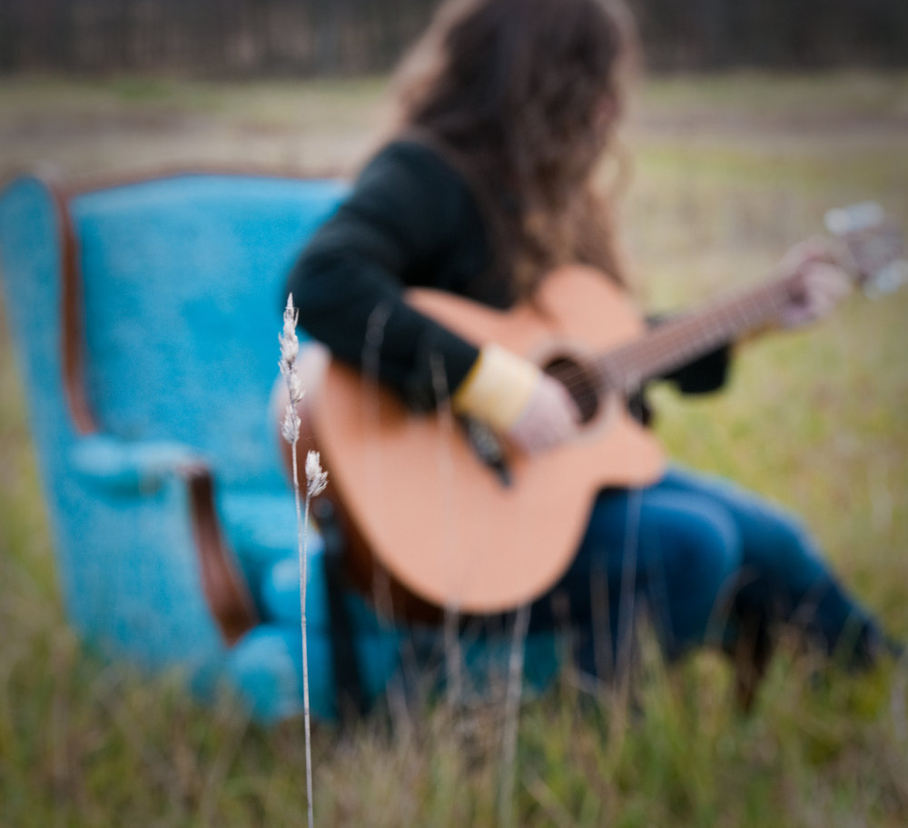 Amy Cox-blue chair-field-guitar-blurred.jpg
