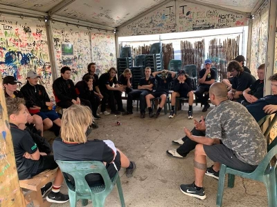 Co-founder Dan Cocker at Paintball, discussing identity with some young men