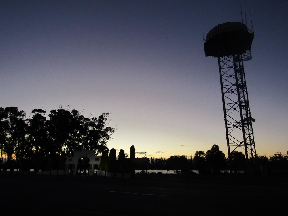 Silhouette of Lake Marma and Water Tower at Sunset