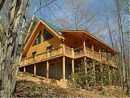 THIS LOG CABIN on the Little River is designed to give you the peace and contentment you've dreamed about! Located in Alleghany County in the heart of the Blue Ridge Mountains and surrounded by forest, it's sure to capture your heart and soul.  Central heat and air conditioning assures maximum comfort throughout the year. A corner gas-log fireplace in living room adds charm and extra warmth on those cool nights. The tin roof produces a sound during a rainy day or night that will surely give you an incredible nap or night's sleep. Tranquility Unlimited features a living/dining room, kitchen, bedroom (with a queen bed), bath and laundry on first floor. The well-equipped kitchen has a Jennaire gas range with regular or convection oven, microwave, and dishwasher. Did we mention the Jacuzzi bath?  The 10-by-30-foot covered front porch overlooking the Little River includes a swing and rockers so you can enjoy the sounds of nature and watch the river roll on. Tranquility Cabin is offering Blue Ridge Fiber Fest vendors and attendees a special rate of $120 night + tax. Just let Margaret know you're with the Fest.   181 Pine River Lane  Sparta NC 28675, US   336-372-8260