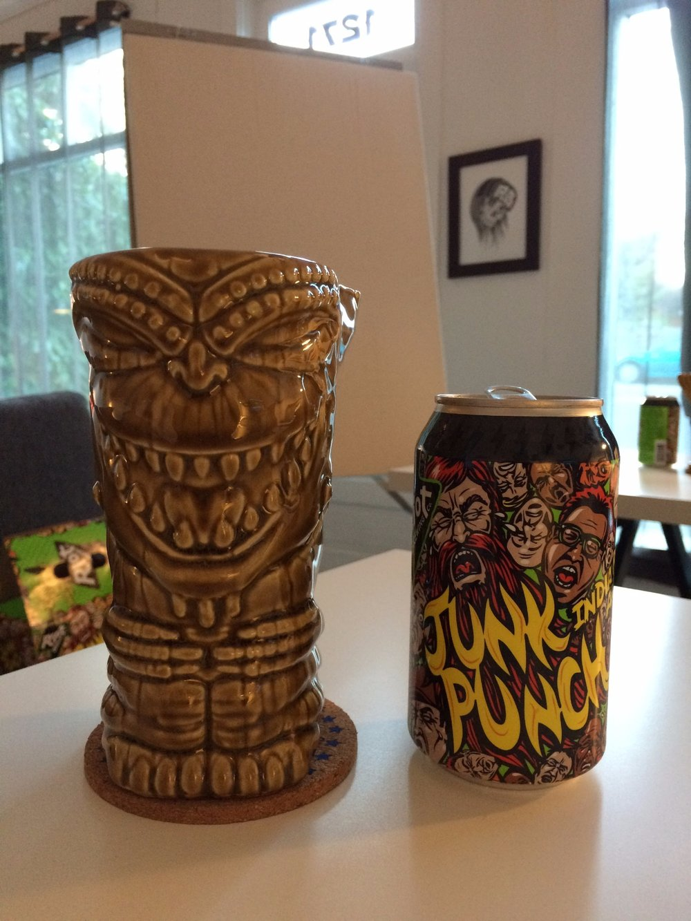 Tiki mug seen with a can of Junk Punch