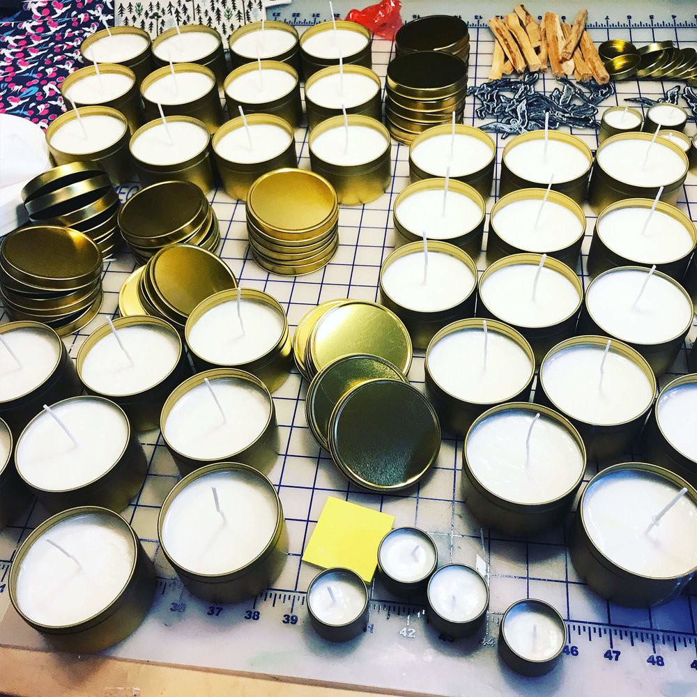 Cooling baby soy candles waiting for a wick trim.