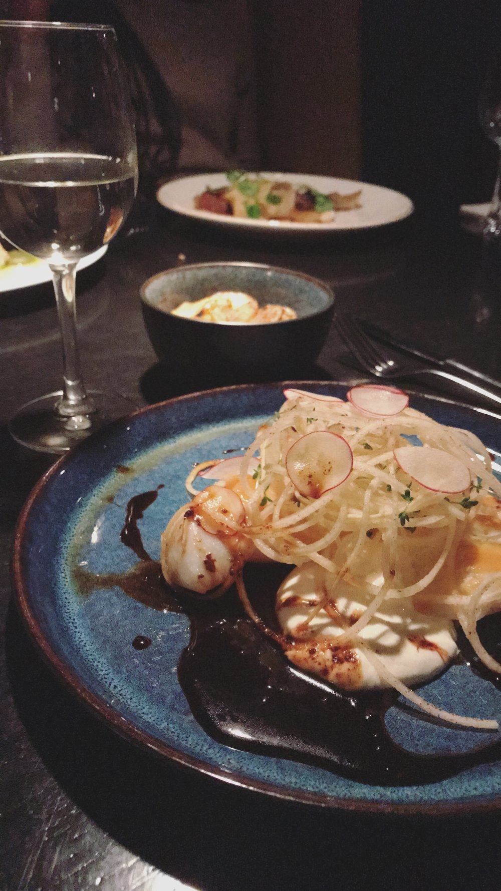 HONG KONG SOY-  sous-vide SALTED COD with SESAME sauce, filtered buttermilk & turnip spaghetti, radish & WASABI salad with a bowl of potatoes & pinot grigio on the side