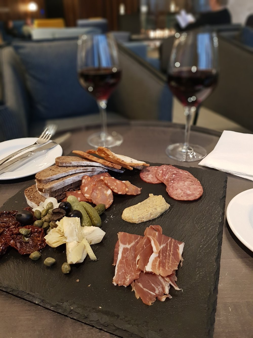 2.   Feel like a tourist with a hotel platter and wine at Crowne Plaza