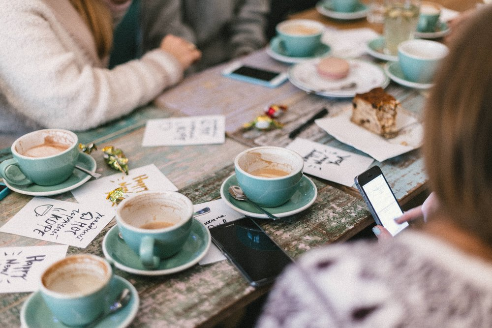 4. Katie and her friends enjoy their hot chocolates,want to come back for more while all in the background, Katie's smartphone has registered her visit for her. -