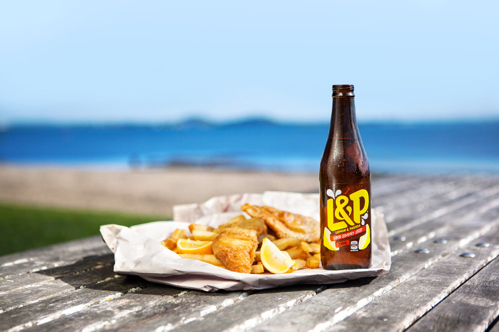 4. Treat yourself to a kiwi classic at the beach - From Ahipara to Ahuriri; Mangonui to the Mount; Paihia to Piha – New Zealand is spoilt for spots to enjoy fish and chips by the sea. The classic kiwi feast of fresh fish served battered, hot and golden brown with a scoop or two of crunchy chips is the perfect way to wind up a summer's day. Whether you're watching a romantic sunset or feeding the family, fish and chips eaten out of newspaper with salt on your skin and sand between your toes is the quintessential Kiwi experience. Wash it down with that other Kiwi classic: a bottle of sweet, fizzy L&P for a treat. It's what summers are made of.