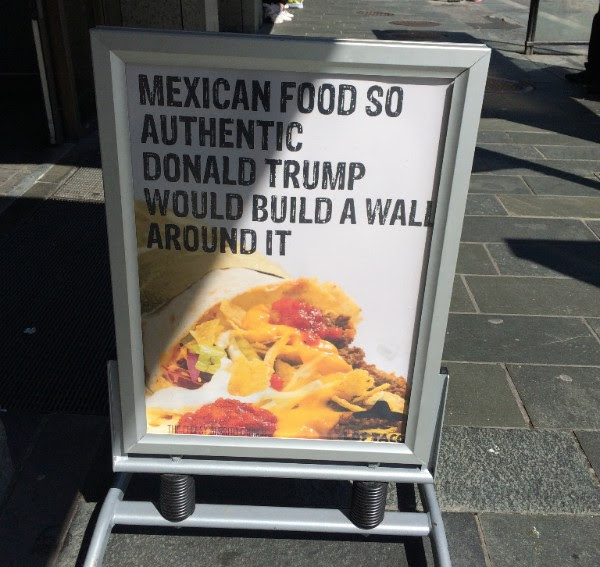 "Photo of a sign outside a restaurant in Norway that reads ""Mexican food so authentic Donald Trump would build a wall around it"""