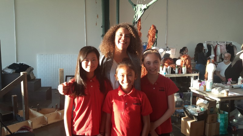 Valérie with SFGC choristers (L-R) Joy Jin, Erin Enriquez, and Sophia Stolte before a West Edge Opera performance