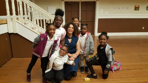 Valérie with several choristers from Dr. Charles R. Drew College Preparatory Academy after class at Bayview Opera House