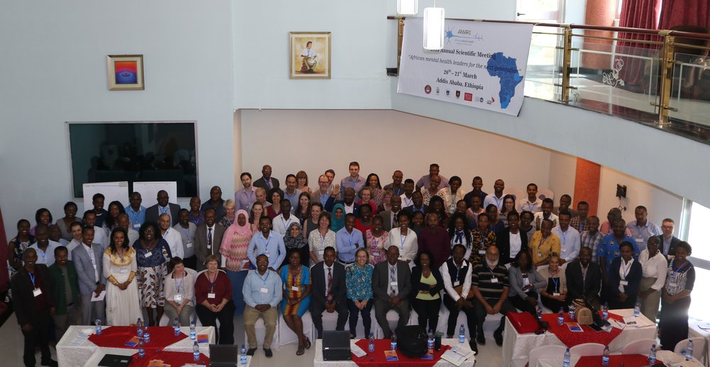 Delegates posing for a group photo at the ASM