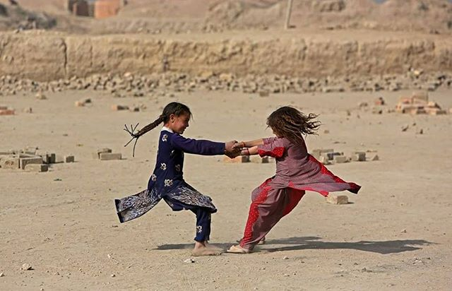Rebirth ©Rahmat Gul October 2016, Afghan girls play on the outskirts of Kabul, Afghanistan Camera Photography #KabulPhotoBinnale