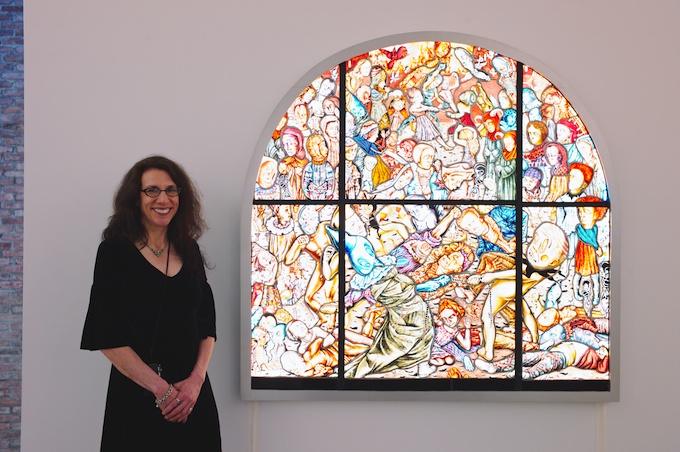 "Artist Judith Schaechter with her work ""The Battle of Carnival and Lent"" at the MAG"