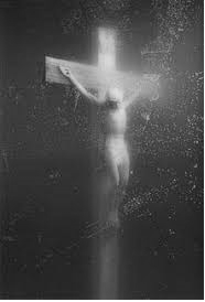 Piss Christ by Andres Serrano (depicted here in black & white)