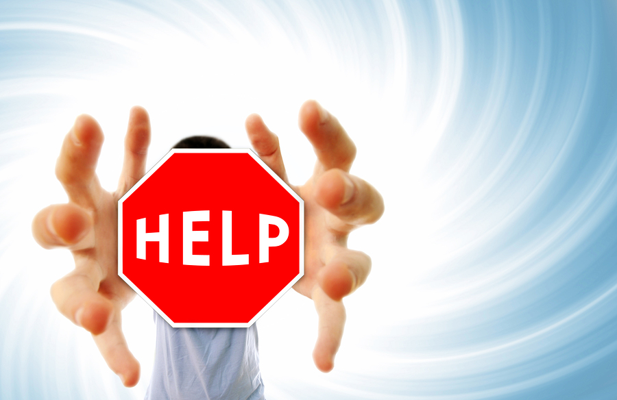 bigstock-Man-Grabing-A-Help-Sign-8176019.jpg
