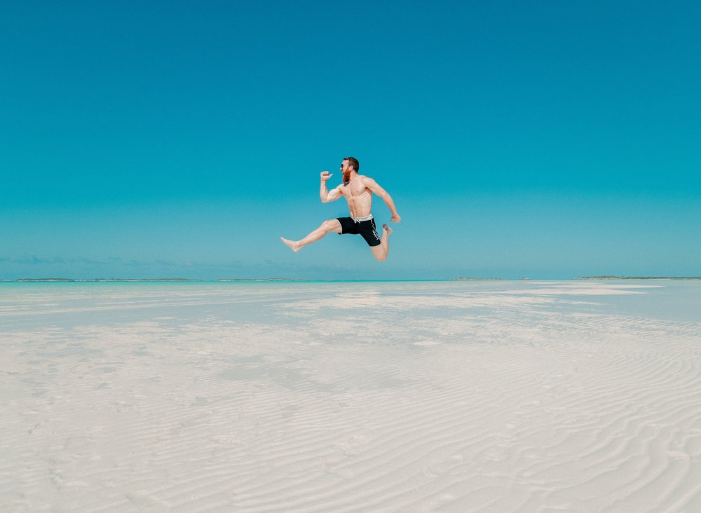 man-jumping-on-the-beach-to-boost-self-esteem.jpg