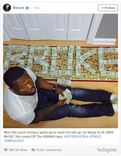 50-cent-poses-with-money