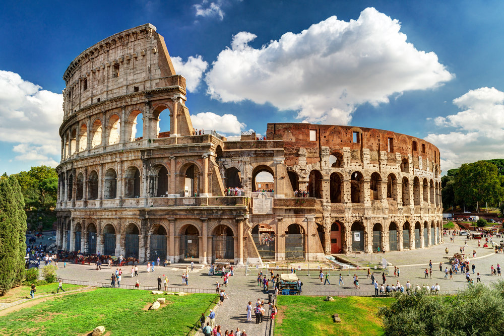 Aug8:9a- 12:30p: Roman Colosseum, Roman Forum and Palatine Hill - Start your tour near Oppian Hill – one of the famous Seven Hills of Rome -- to enjoy panoramic views of the Colosseum, and then stroll down to it with your guide. As Rome's premier crowd-drawing site, the Colosseum regularly attracts long entrance lines. Skip them with your priority-access ticket and head straight inside for your small-group tour.As you walk around the Colosseum's first and second tiers, your guide will keep you entertained with tales of gladiators, mock sea-battles and executions -- a fascinating insight into the amphitheater's gruesome past. Wander its circumference and learn what it must have been like when the crowds were roaring and the gladiator'sEnjoy access to the arena floor, the underground chambers and the third tier. These areas are either newly opened or normally off limits.Walk around the reconstructed arena floor, where the gladiators once fought, and peer down in to the underground chambers below. Then, head below ground to explore them yourself, seeing the pits where lions and tigers were once caged. Your Colosseum experience finishes with a stroll around the third tier where you can enjoy panoramic views into the Colosseum as well as out onto Palatine Hill. After exploring the Colosseum, head outside and walk the short distance to the Roman Forum for an up-close look at some of Ancient Rome's most evocative ruins. See sites like the Temple of Julius Caesar and the intriguing House of the Vestal Virgins, before strolling up Palatine Hill to admire the views of the ruins below. Look down over Nero's Circus Maximus, where chariot races were once held, and then finish your tour on the Palatine Hill – the most famous of the Seven Hills of Rome.