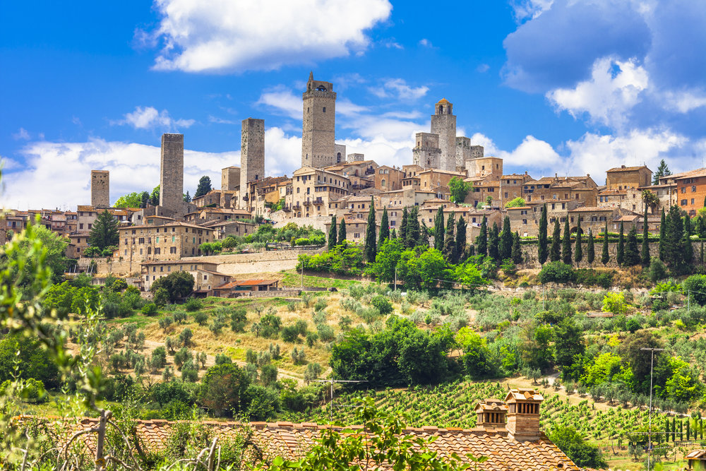Nov 25: San GimignanoCastello Banfi estateSiena - Begin your day with a visit to San Gimignano, a small walled village about halfway between Florence and Siena. Recognized as a UNESCO World Heritage Site since 1990, San Gimignano offers visitors the chance to step back in time while enjoying its local products including saffron and its white wine, the Vernaccia di San Gimignano. Continue on to the family-owned vineyard estate and winery of Castello Banfi, in Brunello di Montalcino. Though it's famous for its award-winning Brunellos, syrahs, merlots, cabernets, and blends, you'll want to stay long after the wine tasting to soak in the spectacular surrounds (the estate boasts 7,000 acres of vineyards, olive groves, and cypress trees).End your day with dinner in Siena. Likely Italy's loveliest medieval city, and a trip worth making, it's been the backdrop in several movies and boasts some of the most beautiful views in Tuscany!