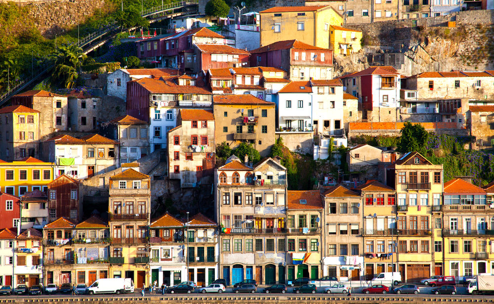 October 11: Depart for Porto via train - This morning, you'll check out of your hotel and find your way to the train station.When your train arrives in Porto, check into your hotel and explore the city!Time has seemingly failed to touch some of the hidden corners of Porto, with many of its typical winding alleys full of shops and restaurants looking like a scene straight out of a medieval history book. The city is so soaked in the past that the historic area of Ribeira has been deemed a UNESCO World Heritage site.Considering the backdrop of wrought-iron balconies full of flowers, the daily washing and an array of fresh white and blue 'azulejos' tiles, you will have the perfect city for aimless wandering. However, the city does have a few key landmarks that are worth a visit, including the elaborately decorated Palacio da Bolsa (=the Stock Exchange Palace), the medieval Cathedral and Clérigos Tower.The other big draw for tourists is the tour of the Porto wine cellars at Vila Nova de Gaia on the other side of the Douro River.The surrounding suburbs of the city are also compelling: Matosinhos offers great seafood eateries and small beaches stretching down the coastline. Amarante invites to a particular colourful shape. Foz do Douro is known as the wealthier area, with nightclubs and restaurants just 5 kilometres northwest of Porto.