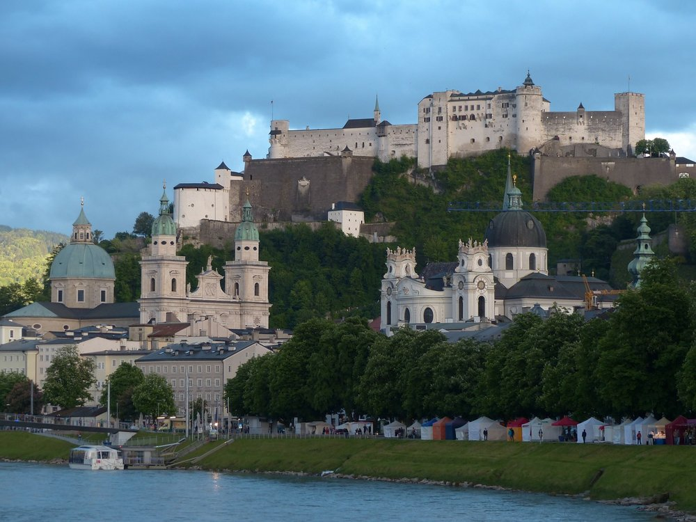 October 14: Train to SalzburgDinner cruise - This morning, you'll check out of your hotel and head to the train station.Experience the baroque city of Salzburg at its most romantic with an evening of sightseeing, cuisine, and live music. You'll cruise the Salzach River through Old Town, a UNESCO World Heritage Site, dine by candlelight at the Salzburg Fortress' Panorama Restaurant, then see Mozart's most beloved works performed inside the historic castle. This Salzburg experience includes the option to upgrade for a VIP experience featuring a special menu, Champagne, and a souvenir program.