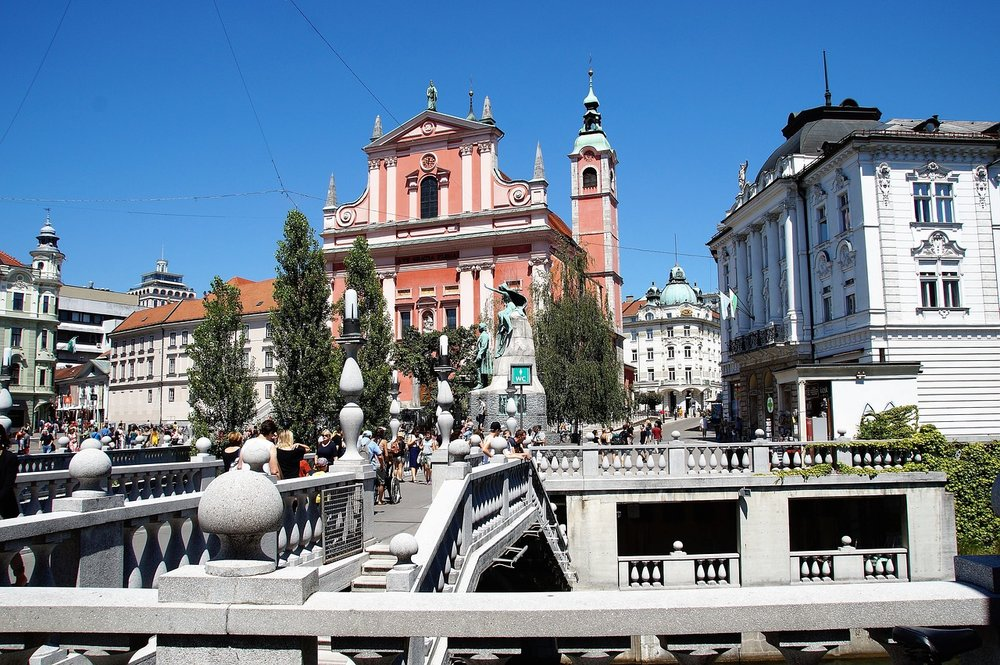 October 18: Explore Ljubljana - Ljubljana is a picturesque city whose image is the product of various historical periods, though it has been marked most notably by the creations of the architect Jože Plečnik. It is distinguished by Ljubljana Castle located on the hill above the city, the Ljubljanica with its wondrous bridges and romantic banks, as well as testimonials and numerous stories from its rich and abundant past accompanying you with every step.Ljubljana's culinary offer is characterised by local ingredients, the adherence to traditional cooking methods as well as the diversity of dishes. Slovene cuisine combines the influences of the Mediterranean and the Balkans, of the Alps and of the Pannonian Basin. Visitors who wish to fully immerse themselves into this world of diversity must not forget to see the Central Market. With a bit of luck, they might even witness one of the culinary events held outdoors during the warm months.