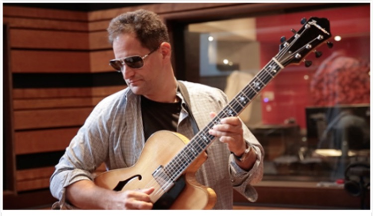 Gideon King - 2 Prodigies and a Rhapsody carved back flat top. Gideon King is a New York City Guitarist and Composer and you can hear his guitars on his CD City Blog.