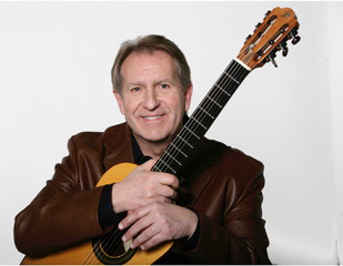 Mike Christiansen - Cabaret with an Implant Pickup. Mike was a professor and Director of Guitar Studies at Utah State University. You can hear his Cabaret on his solo CD