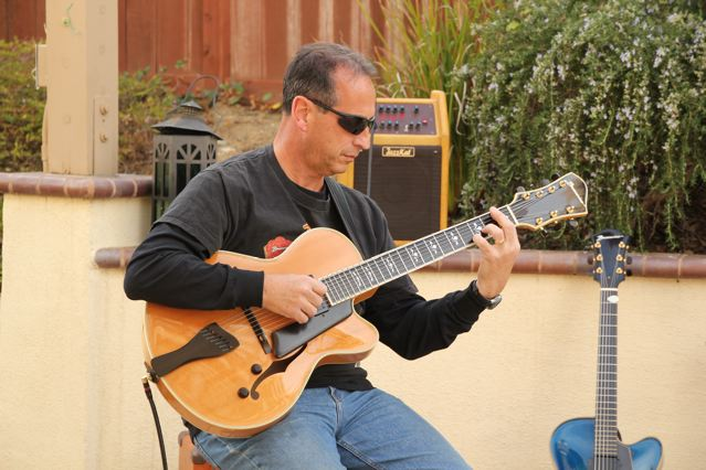 Mike Cea - Mike, long time Buscarino Endorser and friend  has multiple guitars including The Jazzman 7-string electric archtop which is his main axe. He also has a Jazzcaster 7-string solid body, a Blue Artisan Archtop and a 17