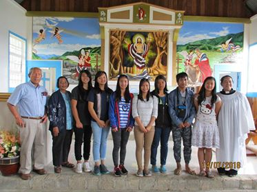 Photo of seven of the Paul C. Laus Educational Trust's first scholarship awardees, taken in July 2018, at a blessing, part of the launching activities for the Scholarship Program. St. Matthew's Church, Banga-an, Northern Sagada, with program director, Dr. Albert Bacdayan, Rev. Mila Ordinario and Arsenia Gomez.