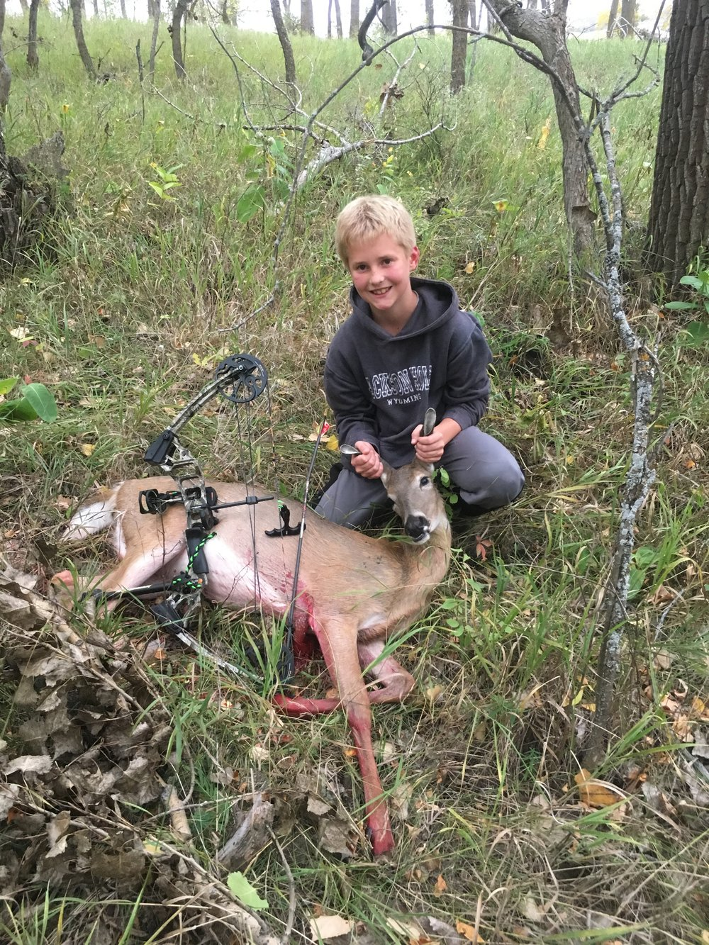 Burleigh County, ND (Private Land) - Name: Finn DockterHometown: Valley City, NDDate of Harvest: September 15, 2018Weapon: BowStory: This was the first deer that my 9 year old has harvested. After he shot we waited for 30 minutes before we started tracking. I let my son take the lead and in less then 10 minutes and about 50 yards he tracked and found the deer. He made a great shot.