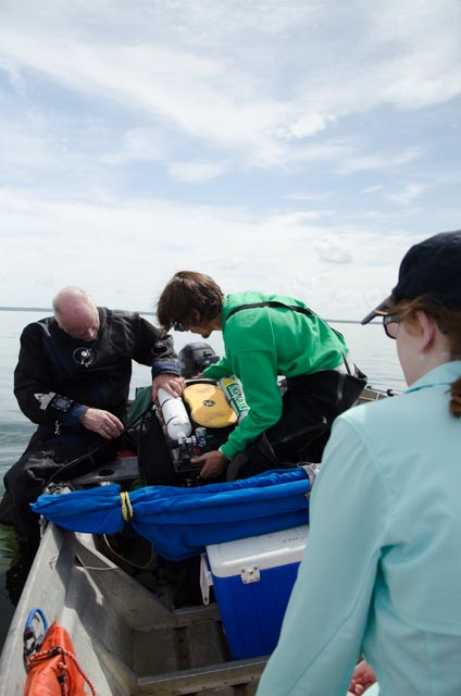 Dr. Garey and Bobby adjusting a rebreather prior to the dive with Madison looking on.