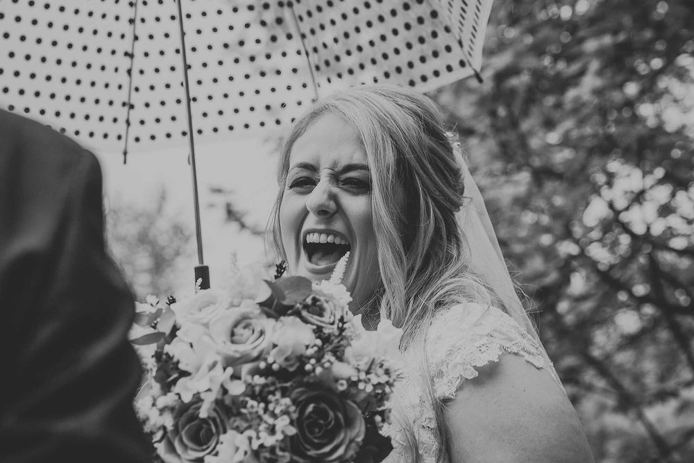 bride laughing East Riddlesden Hall
