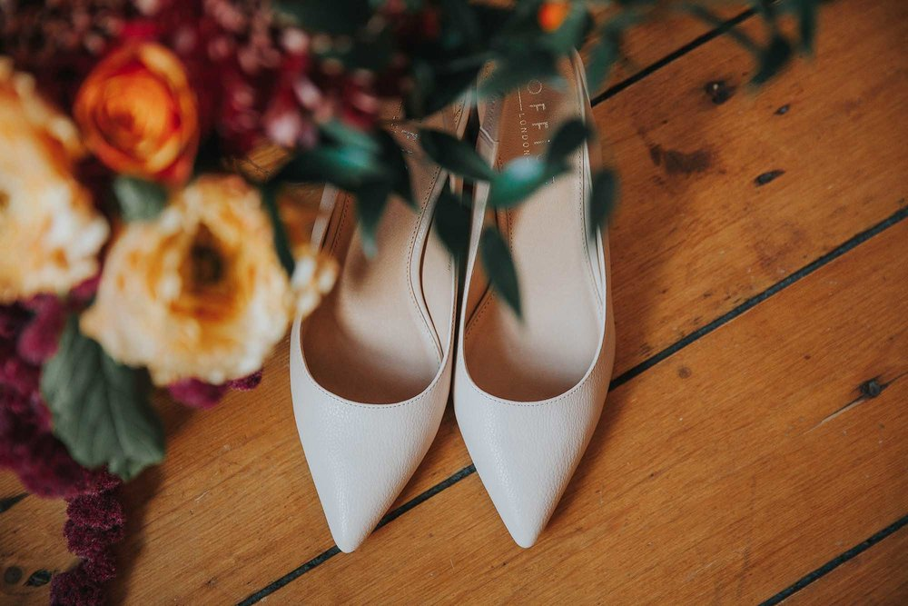 shoes and flowers at a wedding in Todmorden