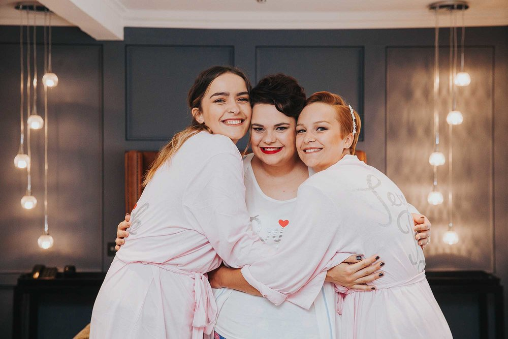 bride and her sisters at The Bridge Hotel & Spa Wetherby