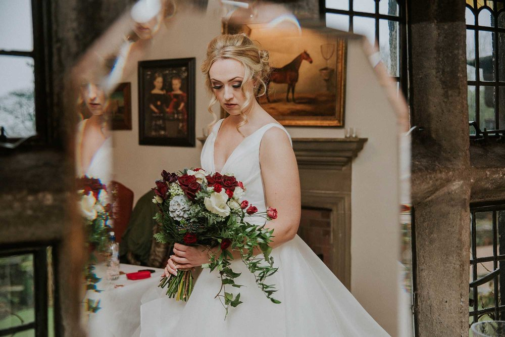 bride's reflection at Holdsworth House