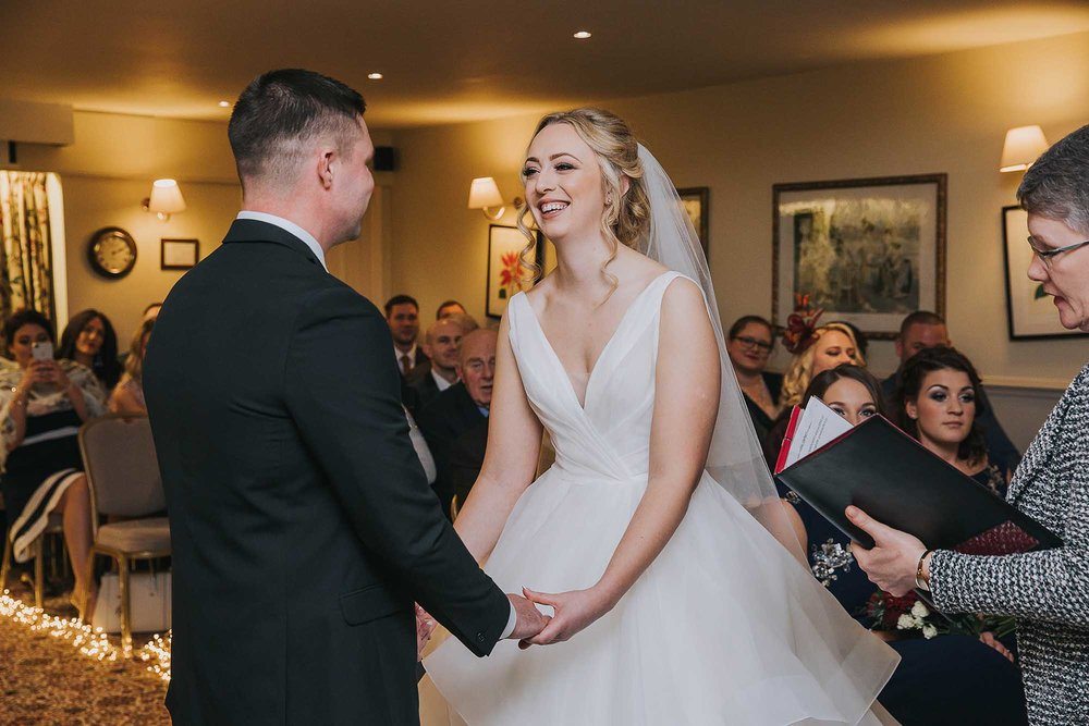 small winter wedding ceremony at Holdsworth House