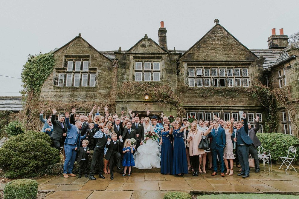 large group photograph outside Holdsworth House