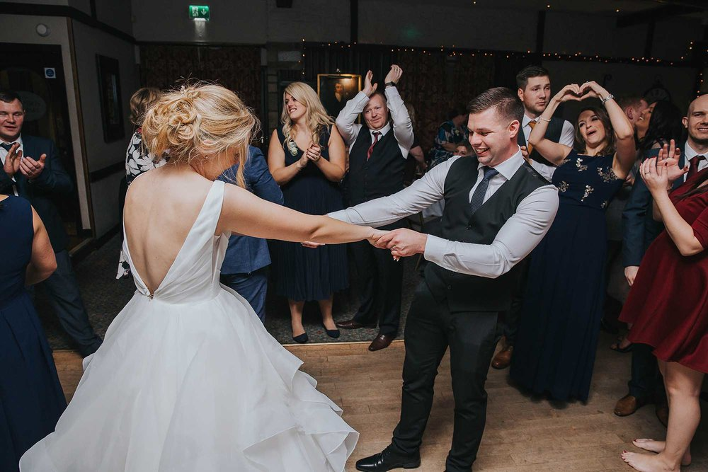 bride and groom enjoying their first dance at Holdsworth House