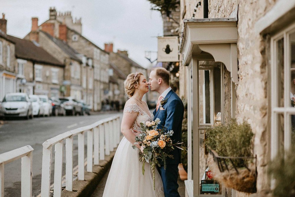 bride and groom have photographs around Helmsley, North Yorkshire