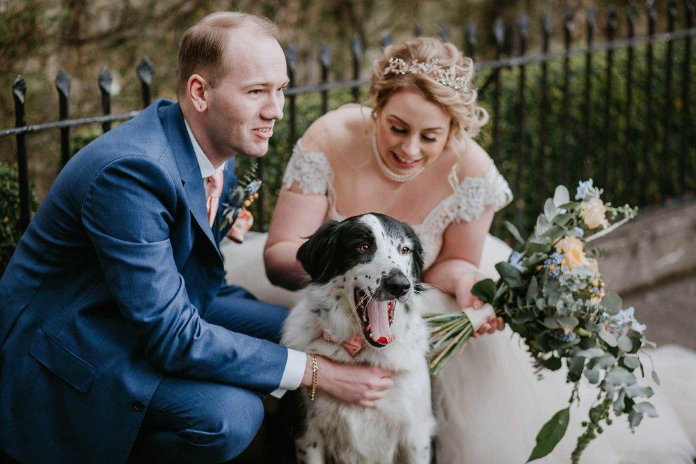 bride and groom with dog wedding photography