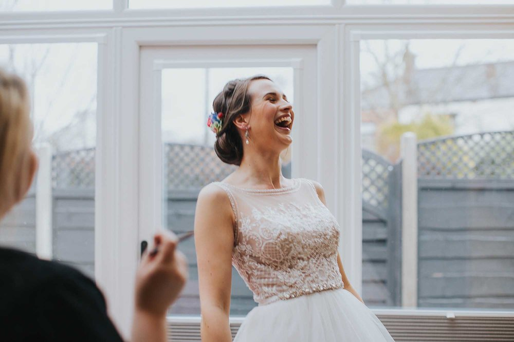 bride laughing before her wedding in Bolton