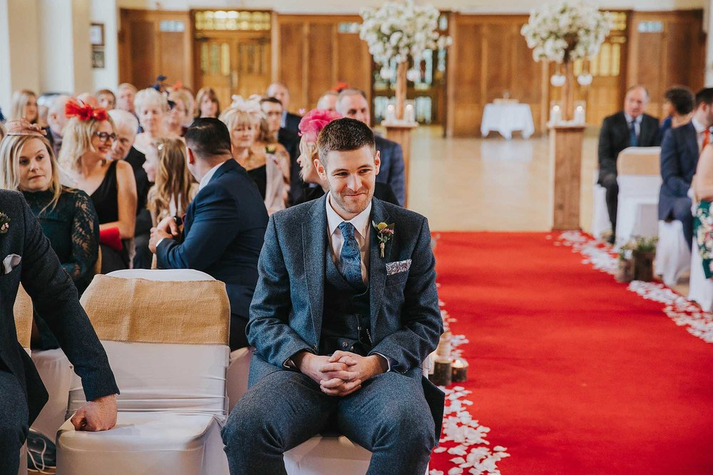 groom waiting at Bolton School wedding