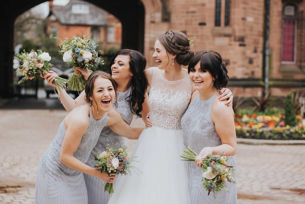 bridesmaids laughing after wedding service at Bolton School