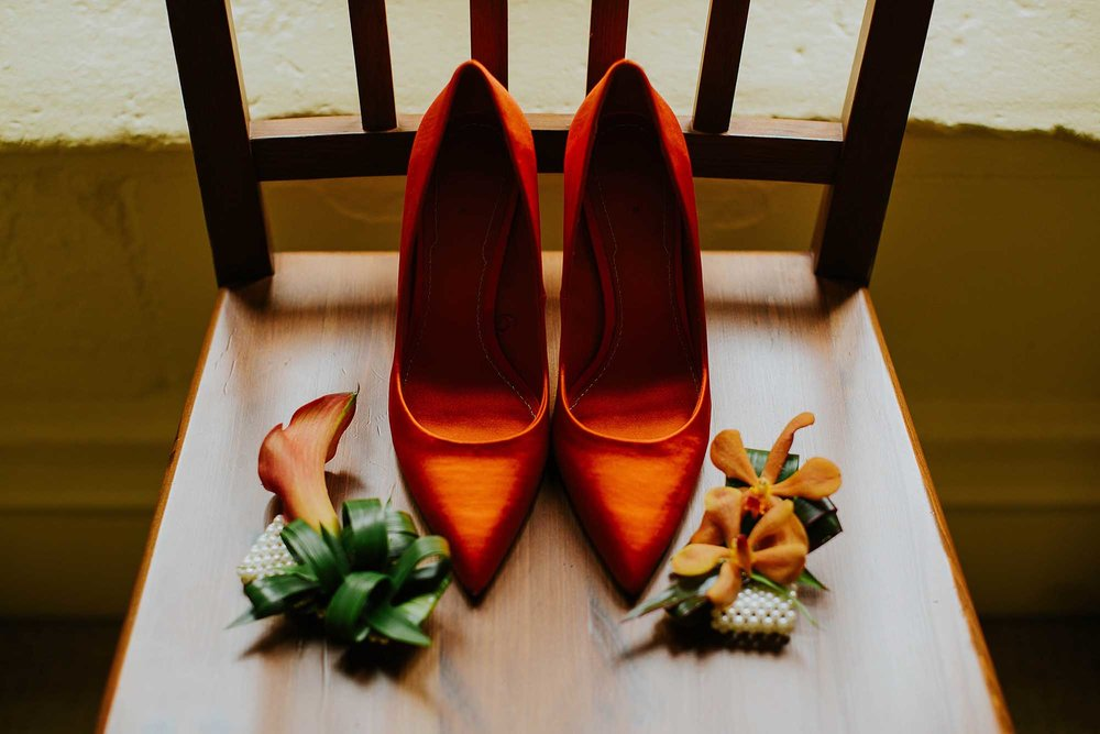 orange bridal shoes and flowers by Holyrood Florist