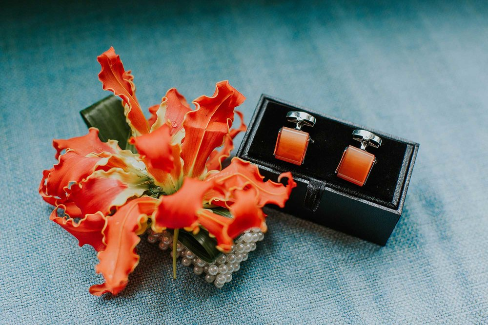 groom's orange cufflinks