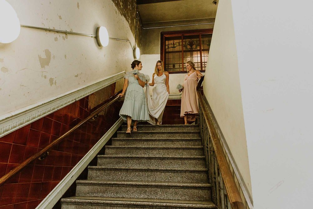 bridesmaids walking down the steps at the Albert Hall Manchester