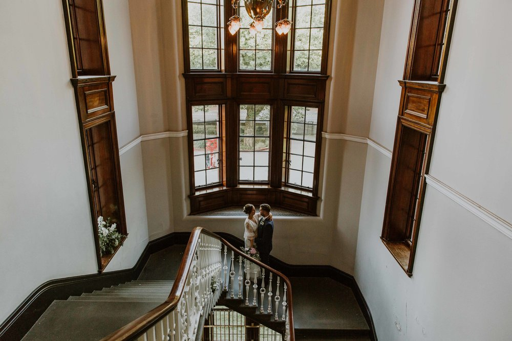 wedding photos on the staircase The Whitworth Art Gallery