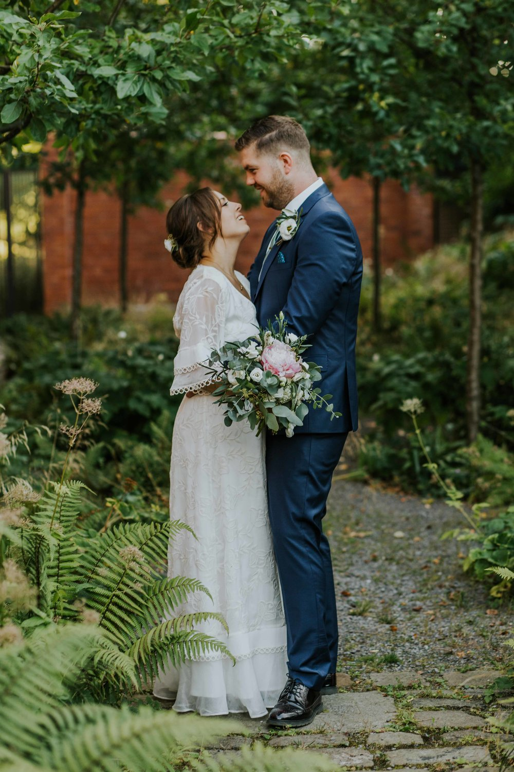 bride and groom portrait in the gardens at The Whitworth Art Gallery Manchester