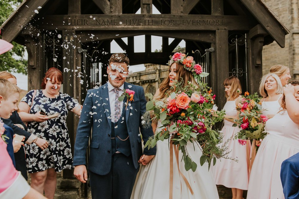 Bride and groom with confetti Leeds