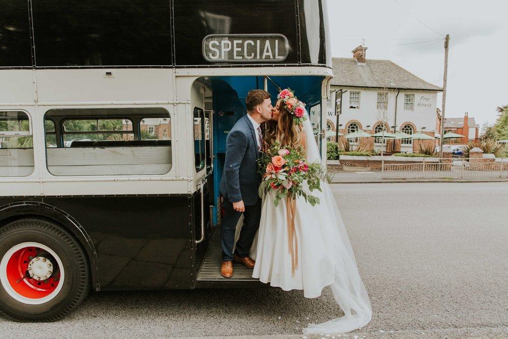 Bride and groom on vintage bus in Leeds